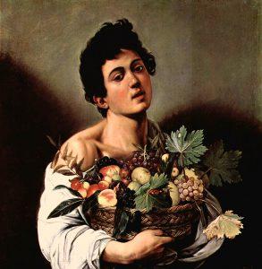 果物かごを持つ少年